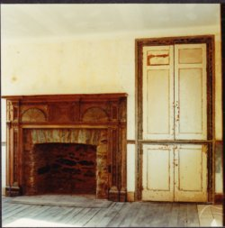 Restored fireplace and door